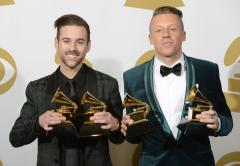 Macklemore & Ryan Lewis perform as Queen Latifah officiates mass wedding