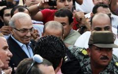 Mubarak's sons, PM Ahmed Shafiq acquitted in corruption trial