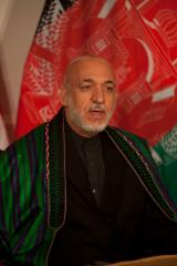 Taliban halt talks; Karzai urges pullback