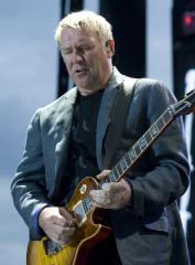 Rush guitarist's son agrees to settlement