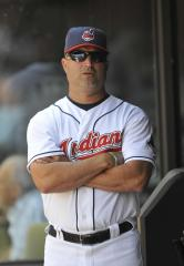 Indians pick up Acta's option for 2013
