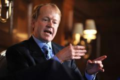 Cisco CEO blames NSA and government shutdown for stock decline