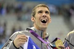 Phelps loses, then sets career record
