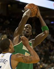Celts' Garnett, others make it official
