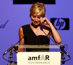 Stone honors Richardson at amfAR event