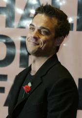 Mom says Robbie Williams is engaged
