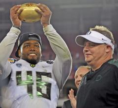 Oregon's Kelly named Eagles head coach