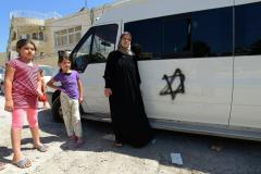 Car tires slashed and graffiti sprayed in East Jerusalem 'hate crimes'