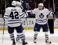 Kessel, Crawford, Calvert earn NHL honors