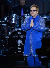 Elton John calls Russian anti-gay law 'inhumane and isolating'