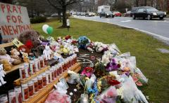 Four funerals held as Newtown mourns
