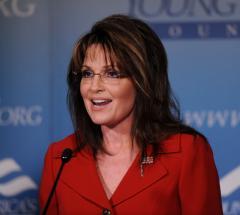 Palin bus tour still on, Sudan trip off