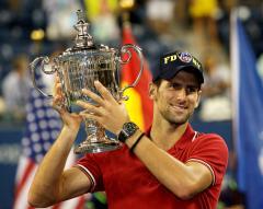 Djokovic survives first-round challenge