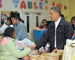 Obama pardons turkey, hands out food
