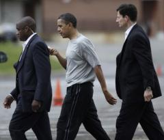 Basketball elbowing injures Obama