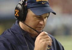 West Virginia sues former football coach