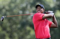 Woods shares Tour Championship lead