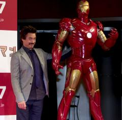 Downey to play Iron Man three more times