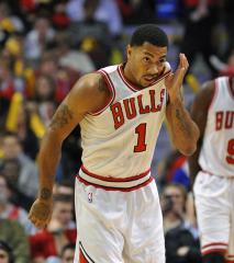 Derrick Rose poses for post-op photo-op following season-ending surgery