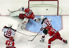 NHL: New Jersey 3, Carolina 2 (OT)