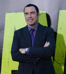 Alley shoots down gay Travolta rumors