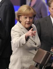 Merkel snubs shared debt despite pressure