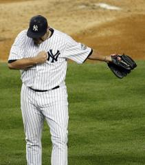 Yankees said split over Chamberlain's role