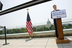 Report: More uninsured under Romney plan