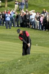Woods still leads at Dubai Desert Classic