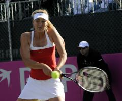 Sharapova, ill, withdraws from Dubai event
