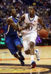 Jayhawks suspend guard Taylor indefinitely