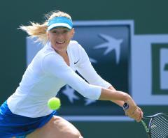 Sharapova, Wozniacki win on retirements
