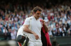 Federer beaten in Wimbledon second round
