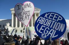 Federal judge strikes down part of Texas abortion law