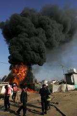 Libyan responders flee fuel depot fire