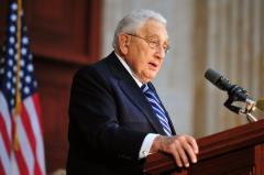 Henry Kissinger gets the pat-down at LaGuardia