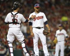 Cleveland and Chicago end spring training in tie