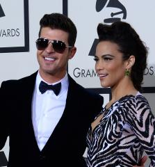 Robin Thicke and Paula Patton reunite for first time since split