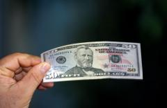 Dollar's gain against euro calms fears