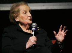 Albright praises Obama, chides Romney