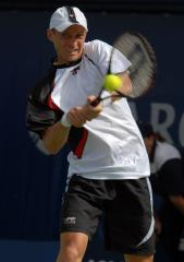 Davydenko, Ferrer claim wins at Hamburg