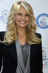Dog barfs on Christie Brinkley