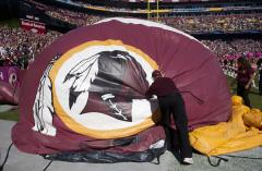 FedEx stays out of Redskins controversy, investors fear backlash