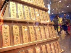 Gold stumbles from 2011 peak