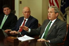 Bush, Paulson pleased by Fed action