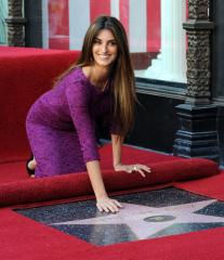Busy Penelope Cruz unveils Hollywood star