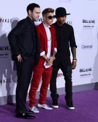 Justin Bieber joined in Panama by mentor Usher and manager Scooter Braun
