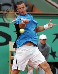 Safin's career ends with loss in Paris