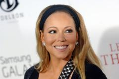 Mariah Carey says she was spat on because of her race