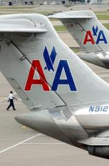 American Airlines charges for checking bag
